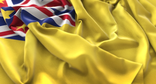 Niue flag ruffled beautifully waving macro close-up shot