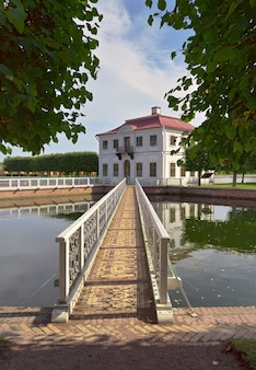 Nizhny park marly palace in reflection on the surface of the water classical architecture