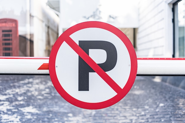 No auto parking sign bolted to barrier in the city