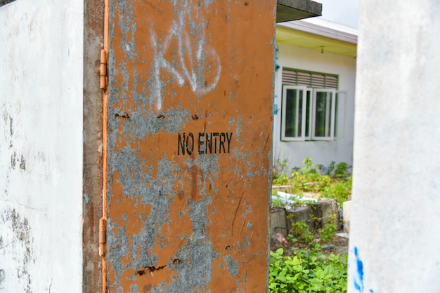 No entry sign on door,old dirty label of no entry signal concept