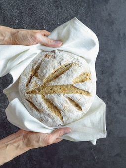 No knead baked bread in a hand