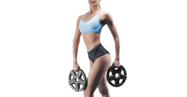 Безымянный портрет высокой спортивной женщины с гантелями в руках. понятие о спорте, бодибилдинге, фитнесе, аэробике. здоровый образ жизни. смешанная техника