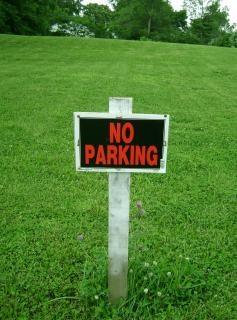 No parking sign on grass