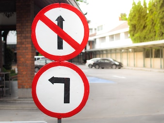 No passing traffic sign and turn left at the public car park.