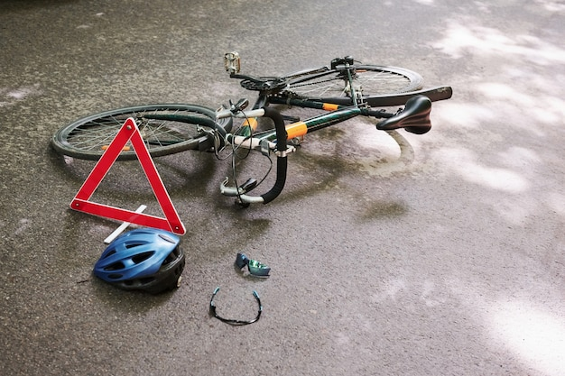 No people. place of hit. bicycle accident on the road in forest at daytime