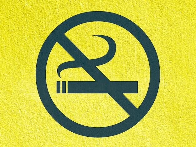 A no smoke arrow points painted on a stucco wall outside