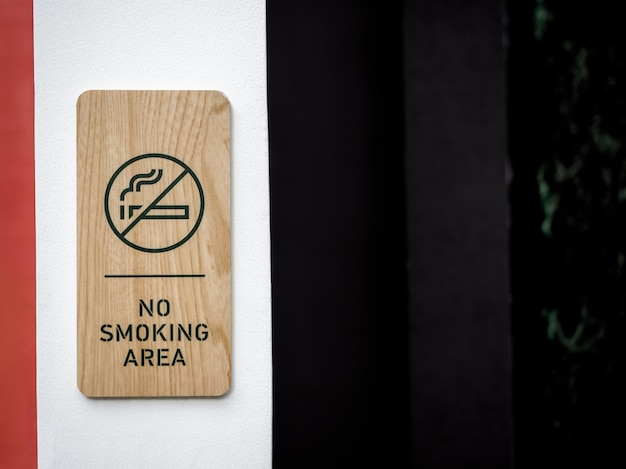No smoking area wooden sign