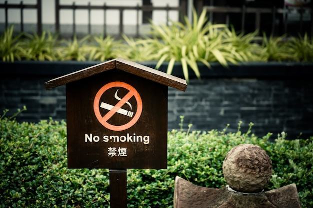 No smoking label put on wooden plate