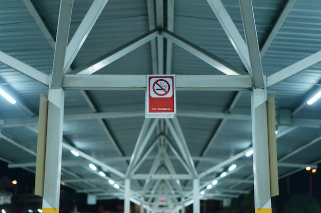 The no smoking sign banner in car parking lot outdoor