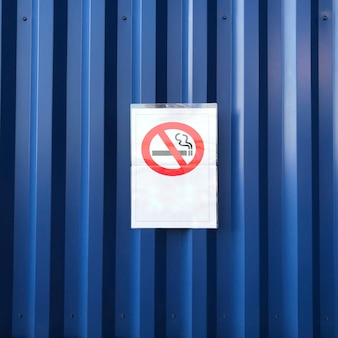 No smoking sign on a blue wall