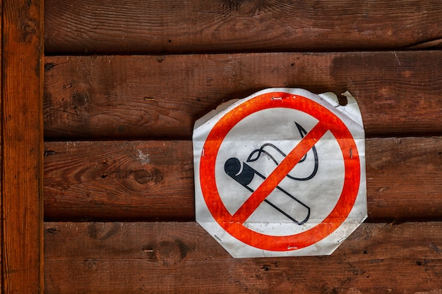 No smoking sign on brown wooden  wall