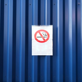 No smoking sign on blue wall