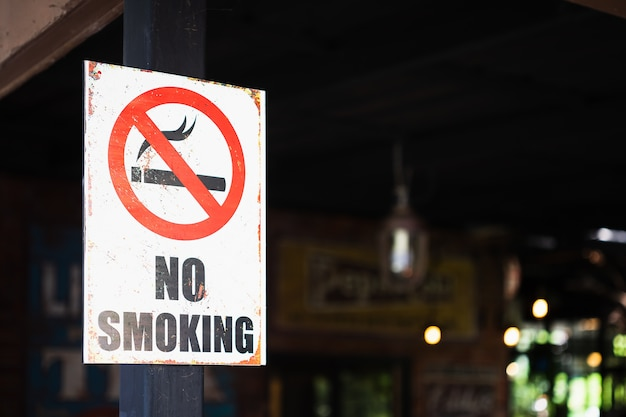No smoking sign, outdoor in front of a restaurant