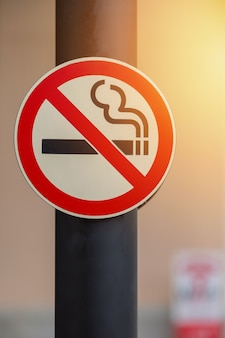 No smoking sign on public place background
