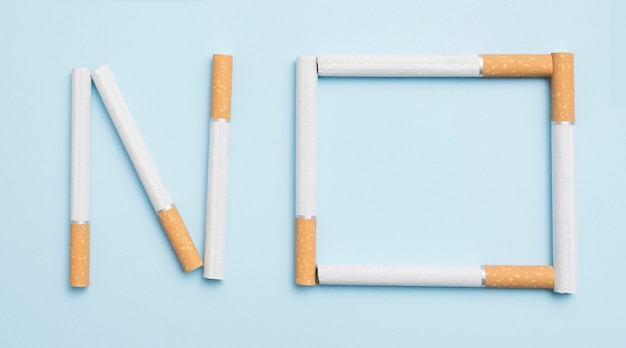 No text made with cigarettes against blue backdrop