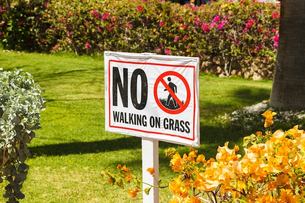 No walking on grass warning sign in the garden