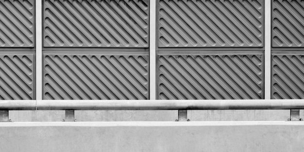 Noise barrier wall on a highway - monochrome