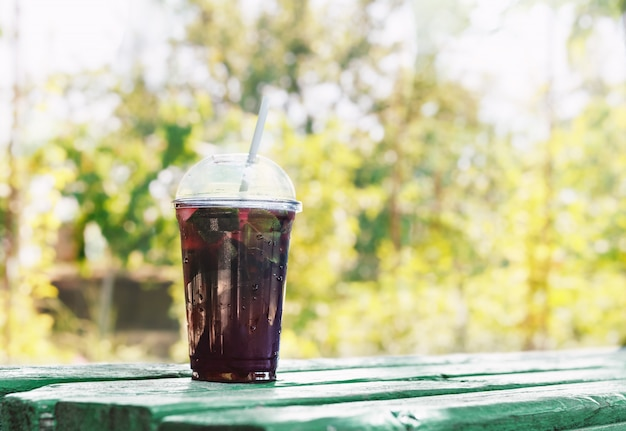 Non-alcoholic berry take away beverags in plastic cup.