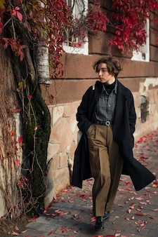 Non binary person posing in an artistic way outdoors