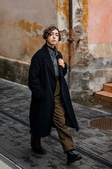 Non binary person in vintage clothes walking