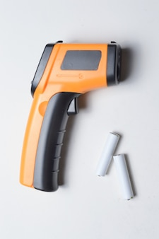 Non-contact handheld pyrometer thermometer, yellow. and batteries for it.