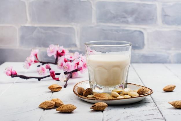 Non dairy vegan almond milk in a tall glass