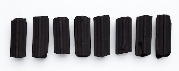 Non smoke wood charcoal on white background.