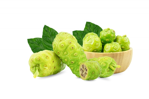 Noni or morinda citrifolia and pieces in a wooden cup