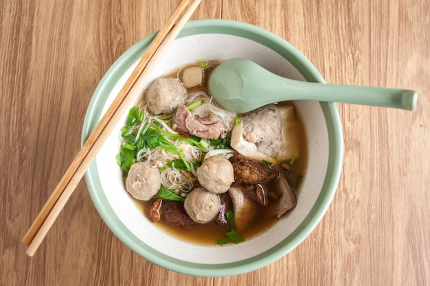 Noodle meat ball and pork tofu on soup, thai noodle in the bowl