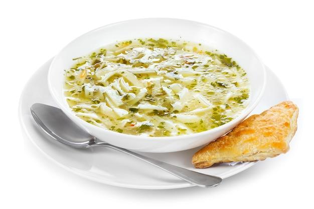 Суп с лапшой на белом фоне