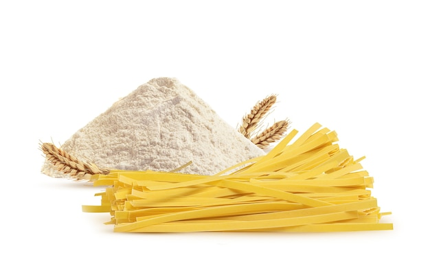 Noodles pasta from wheat flour on a white surface