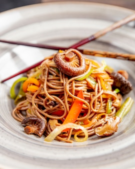 Noodles prepared with mushrooms bell peppers and sauce