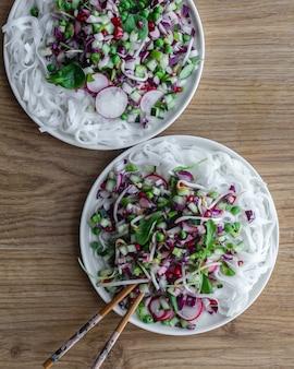 Noodles salad, vegetables and sesame oil. asian food.