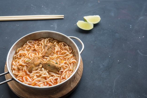 Noodles with chicken meat in bowl