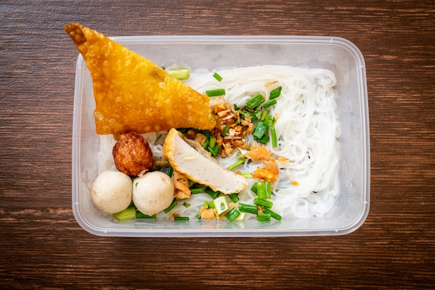Noodles with fish ball and minced pork in delivery box - asian food style
