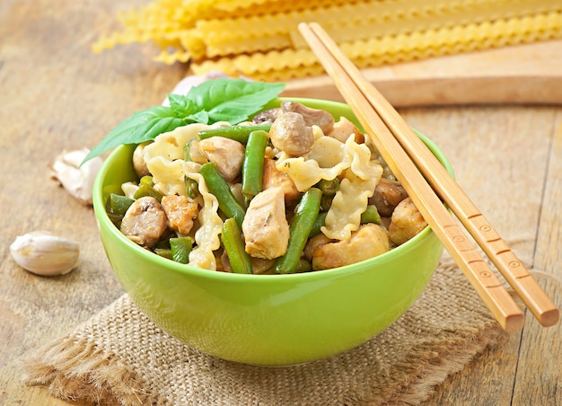 Noodles with meat, beans and mushrooms