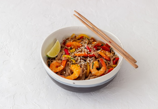 Noodles with shrimps, pepper and soy sauce.