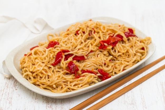 Noodles with vegetables on white dish