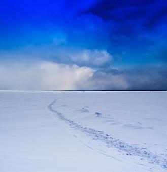 Nordic frozen fishing lake landscape