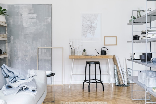 Nordic home interior with wooden desk, chair, design sofa, coffee table, bookstand and art accessories
