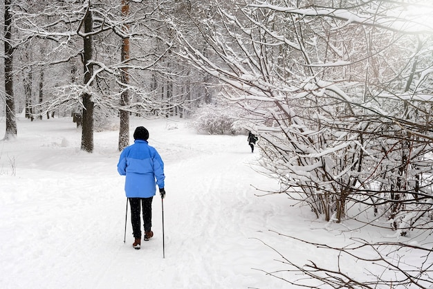 Nordic walking in the winter park.
