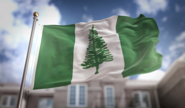 Norfolk island flag 3d rendering on blue sky building background