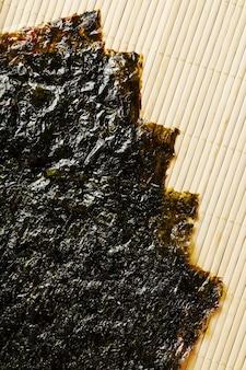 Nori algae leaves on a bamboo substrate