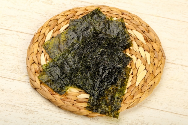 Nori sheets over wooden background