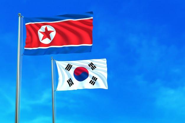Флаги северной и южной кореи на фоне голубого неба