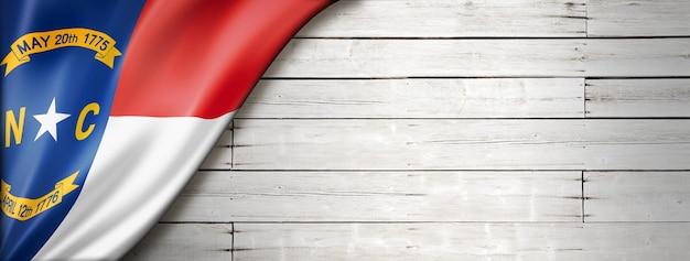 North carolina flag on white wood wall , usa. 3d illustration