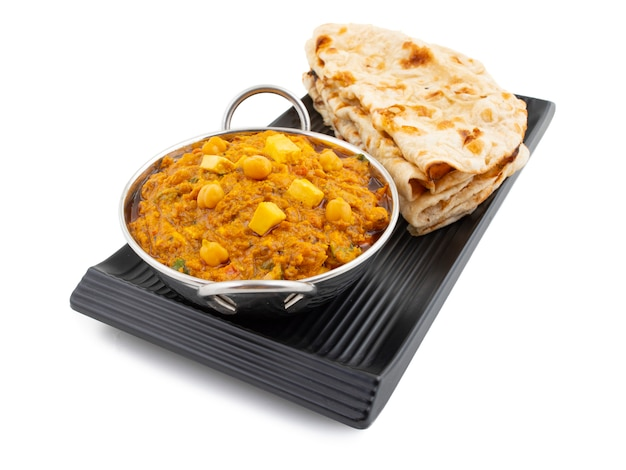 North indian healthy cuisine chole paneer on white background