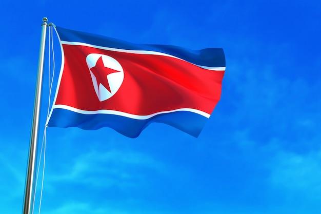 Флаг северной кореи на фоне голубого неба