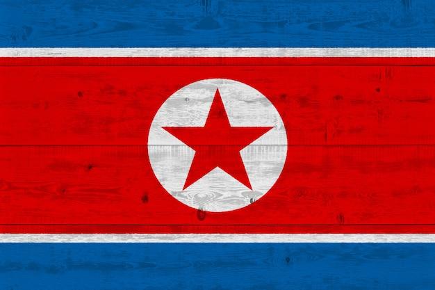 North korea flag painted on old wood plank