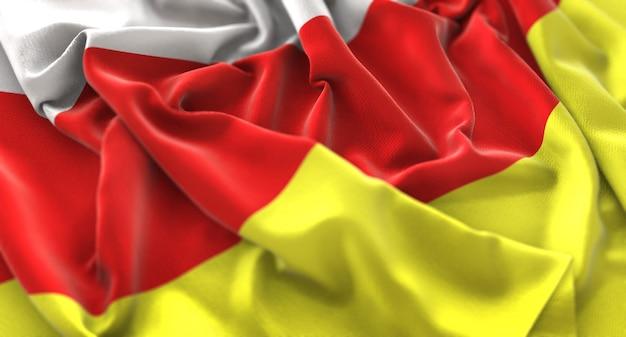 North ossetia-alania flag ruffled beautifully waving macro close-up shot